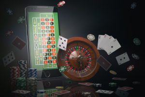 Online,Casino,Concept.,Mobile,Phone,,Roulette,With,Casino,Chips,,Slot